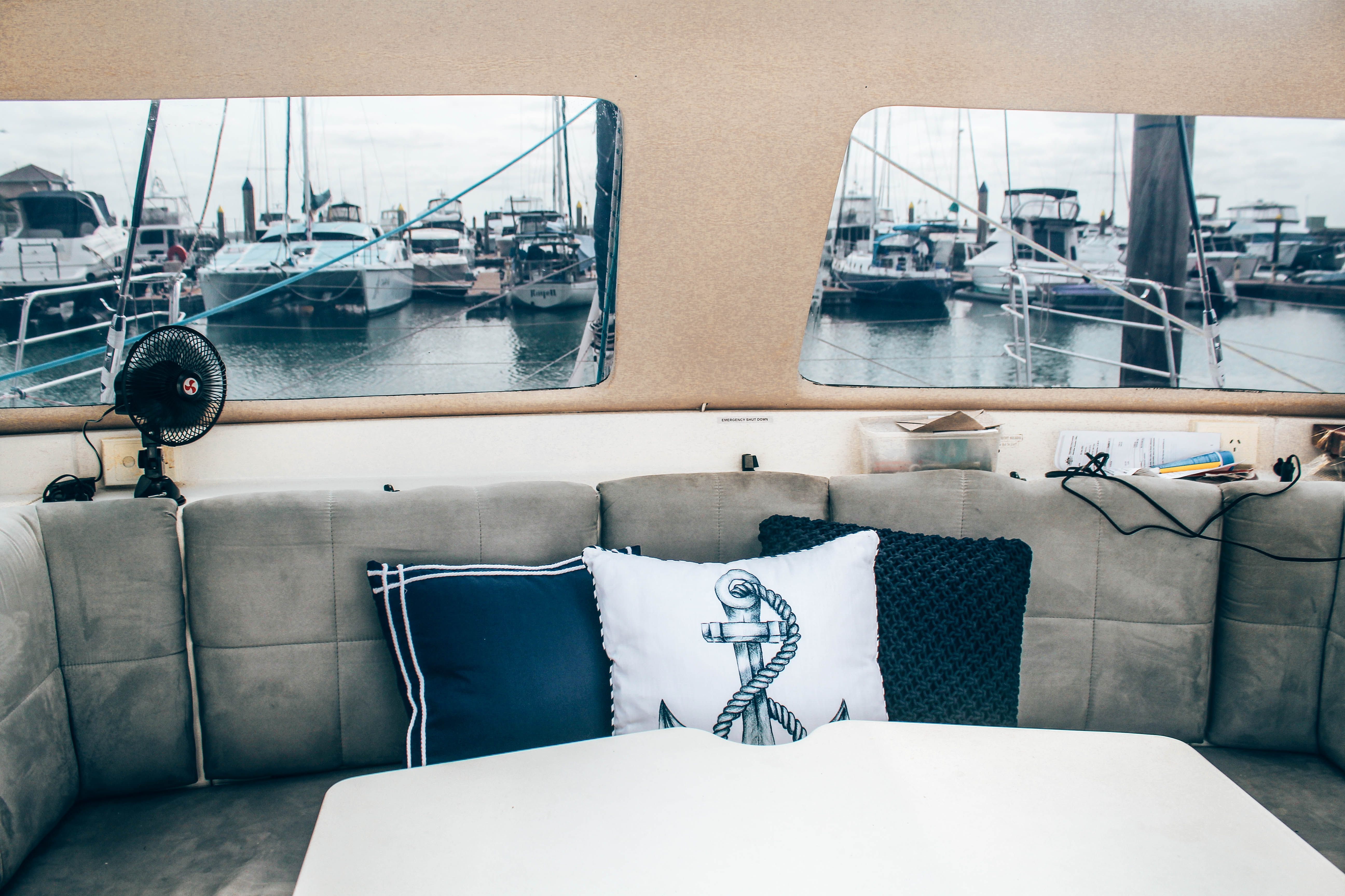 Table and lounge on board yacht hire, Indigo
